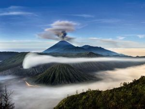 "NGC Beautiful Indonesia - Mount Semeru and Bromo ""Some Indonesians believe that belching volcanoes such as Mount Semeru (in background) and Mount Bromo (in foreground) are portals to a subterranean world that has shaped not only Indonesia's landscape but also its beliefs and culture. A long exposure time captured stars in this photo—and the brief balanced light from both a fading moon and a brightening eastern sky""."