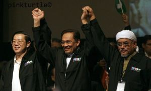 Malaysia's opposition leaders hold hands at the end of their People's Alliance conference in Shah Alam