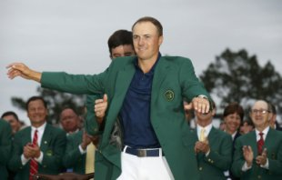 Defending champion Watson of the U.S. puts the traditional green jacket on compatriot Spieth after Spieth won the Masters golf tournament at the Augusta National Golf Course in Augusta
