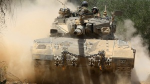 Israeli tanks maneuver in Israel near Gaza border