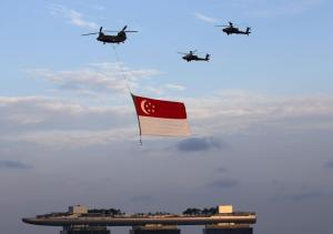 The Republic of Singapore Air Force helicopters fly past with the national flag during a Golden Jubilee celebration rehearsal in Singapore August 1, 2015.  REUTERS/Edgar Su
