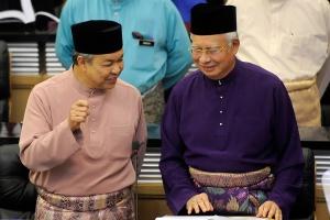 Malaysia Prime Minister Najib Razak (R) listens to his deputy Ahmad Zahid Hamidi as they arrive at the Parliament House in Kuala Lumpur on October 23, 2015. The Malaysian Insider/Najjua Zulkefli