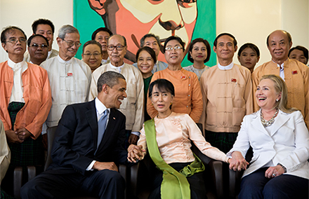 President Barack Obama and Secretary of State Hillary Rodham Clinton are photographed with Aung San Suu Kyi and her staff at her residence in Rangoon, Burma, Nov. 19, 2012. (Official White House Photo by Pete Souza) This official White House photograph is being made available only for publication by news organizations and/or for personal use printing by the subject(s) of the photograph. The photograph may not be manipulated in any way and may not be used in commercial or political materials, advertisements, emails, products, promotions that in any way suggests approval or endorsement of the President, the First Family, or the White House.Ê